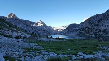 Sun setting on Evolution Lake & Basin